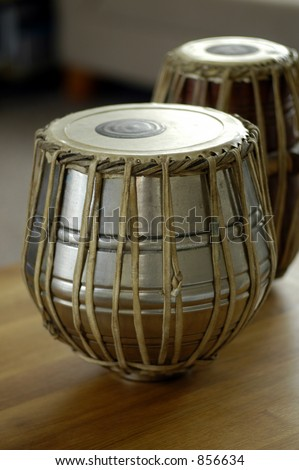 A pair of tablas on a wooden table - stock photo