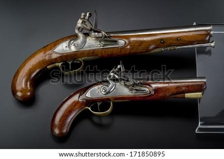 A pair of 18th century British flintlock pistols. - stock photo