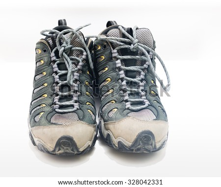 A pair of unbranded men hiking/trekking shoes or boots isolated on the white background. Copy space
