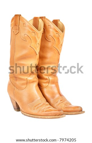 A pair of used cowboy boots isolated on white background - stock photo