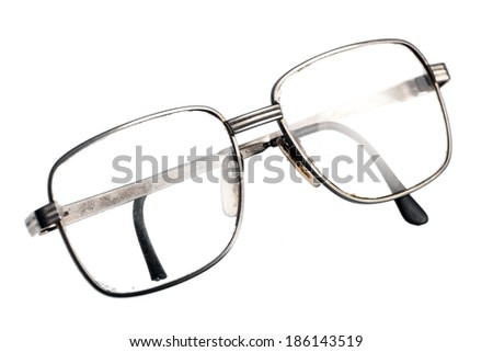 A pair of used glasses, isolated on white. - stock photo
