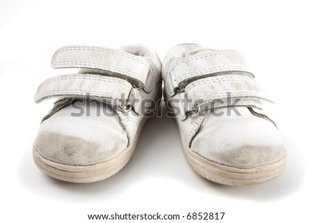 a pair of used kid trainers isolated on white - stock photo
