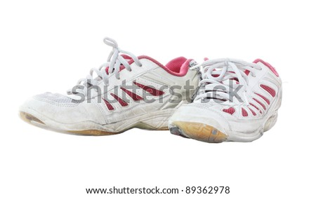 A pair of used sport shoes isolate on white background - stock photo