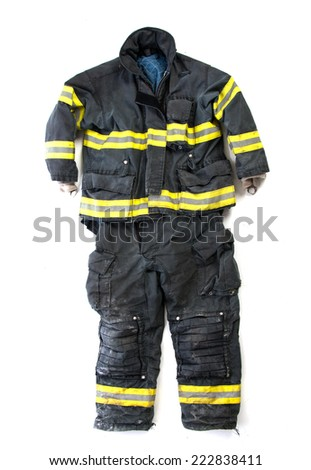 A pair of used worn firefighter pants and suit isolated display on white background - stock photo
