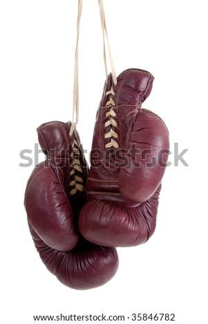 A pair of vintage, antique boxing gloves on a white background - stock photo
