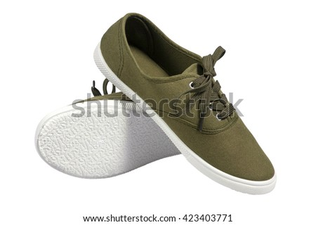 A pair of walking green sneakers isolated with clipping path. - stock photo