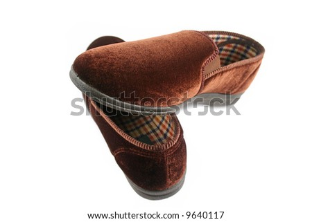 A pair of warm and comfy mens slippers. - stock photo