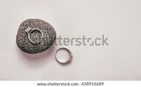A pair of wedding rings shot from above on a white background with copy space.