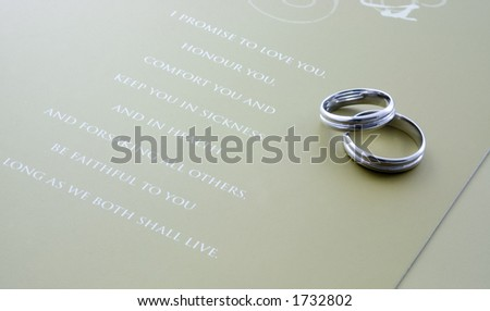 A Pair Of Wedding Rings With Wedding Vows