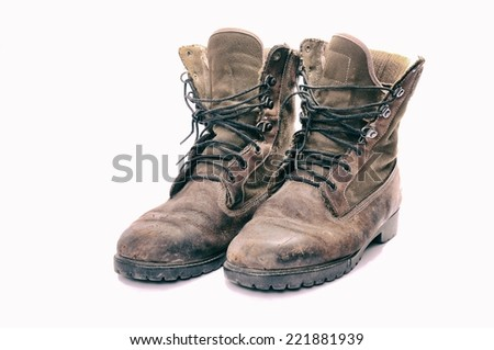 A pair of well worn Work Boots.  - stock photo