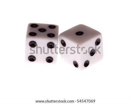 a pair of white dice with black dots on white, lit from underneath