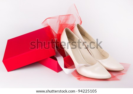 A pair of white shoes as a present