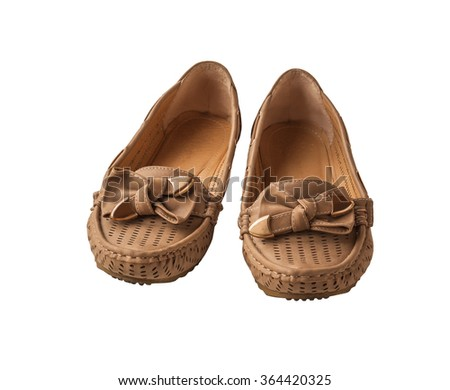 A pair of women beige moccasins  isolated on a white background