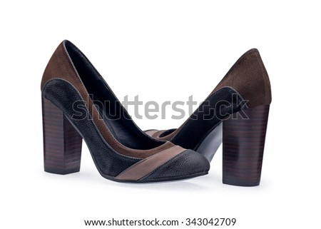 A pair of women's shoes black stilettos with a decorative belt on a white background - stock photo
