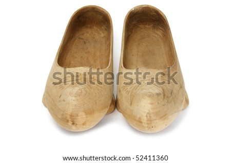 a pair of wooden clogs isolated on a white background