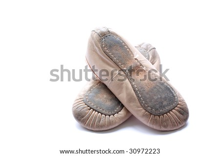 a pair of worn ballet shoes - stock photo