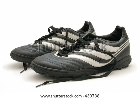 A pair of worn indoor soccer boots - stock photo