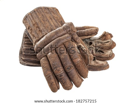 A pair of worn leather hockey gloves isolated on a white background. - stock photo