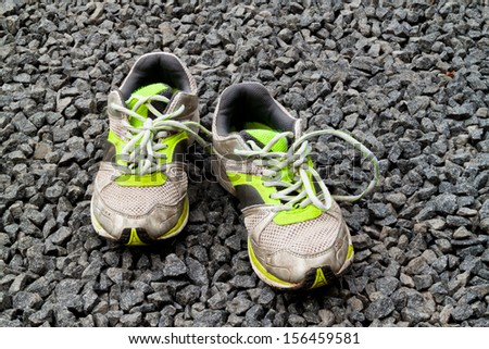A pair of worn out running shoes - stock photo