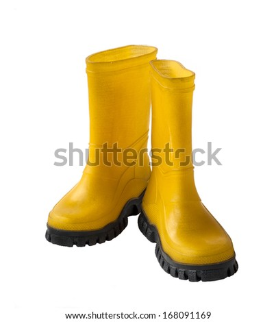 A pair of yellow gumboots isolated on white background - stock photo