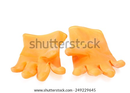 A pair of yellow rubber gloves over white background - stock photo