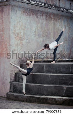 A pair of young ballet dancers performing in the outdoors - stock photo