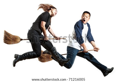 A pair of young folks flying like witches - stock photo