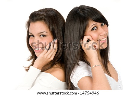 A pair of young women on the phone together - stock photo
