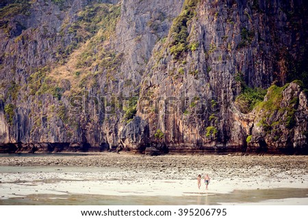 A pair walking at Maya bay, Phi-Phi, Thailand. Image with selective focus and toning - stock photo