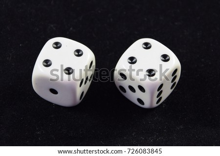 A pair white of dice showing Double Four