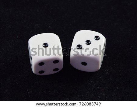 A pair white of dice showing Three and One
