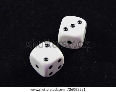 A pair white of dice showing Three and Two