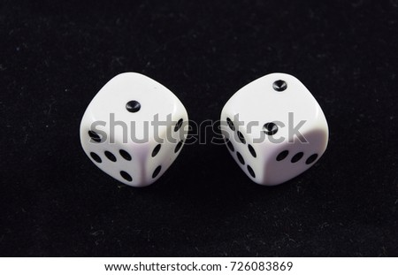 A pair white of dice showing Two and one