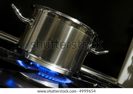 A pan on a gas burner - stock photo