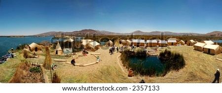 A panaramic view of one of the floating reed islands on Lake Titicaca - stock photo
