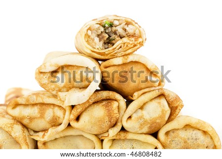 a pancakes with meat and rice closeup
