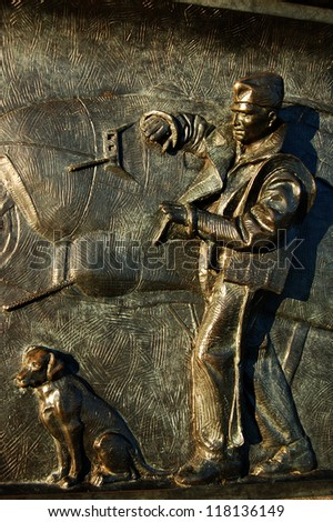 A panel from the National World War II Memorial in Washington, D.C. depicting a B-17 Flying Fortress pilot and a dog - stock photo