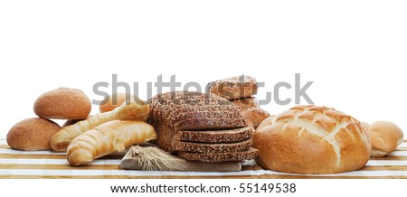 A panorama of assorted baked breads.  Shot on white background. - stock photo