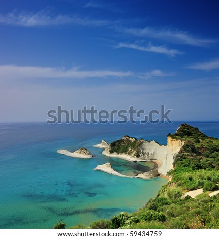 A panorama of Cape Drastis with nearby islands on Corfu island, Greece - stock photo