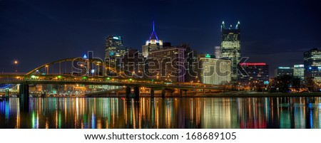 A panorama of downtown Pittsburgh, Pennsylvania at night from the North Shore. - stock photo