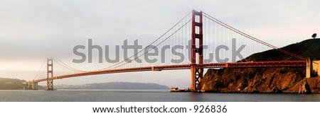 A panorama of Golden Gate Bridge at dawn. A cold, foggy, November morning... - stock photo
