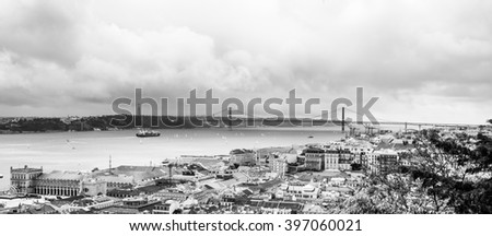 A panorama of Lisbon with the river and the 25 de Abril bridge - stock photo