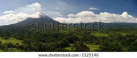A panorama of the Arenal volcano in Costa Rica. - stock photo
