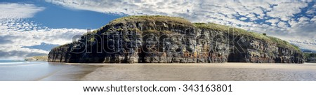 a panorama of the cliffs and beach on the wild atlantic way in ballybunion county kerry ireland - stock photo
