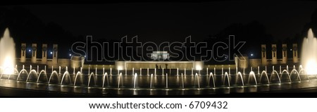 A panorama of the Lincoln Memorial at night with the World War 11 Memorial in the foreground, Washington, DC. - stock photo
