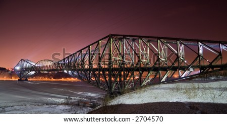 "A panorama of the ""Pont de Quebec"" at night in winter"