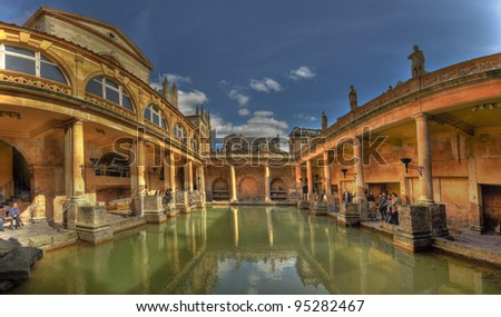 A panorama of The Roman Baths in Bath, England on a bright, sunny day. - stock photo