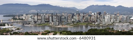 A panorama of Vancouver, BC, Canada extending from English Bay and a point of Stanley Park, through the West End, along False Creek, downtown, and Yaletown.