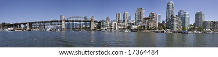 A panorama of Vancouver's Burrard Street Bridge and False Creek. - stock photo