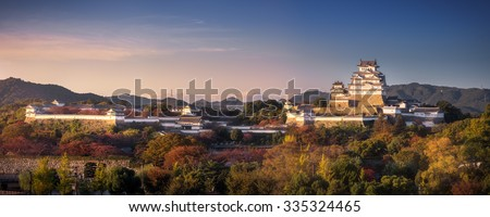 A panorama view of Himeji Castle at early of autumn, Himeji, Japan. The castle is regarded as the finest surviving example of Japanese castle architecture. It is a UNESCO World Heritage Site. - stock photo